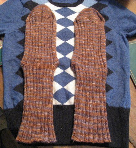 knitted socks on the old sweater